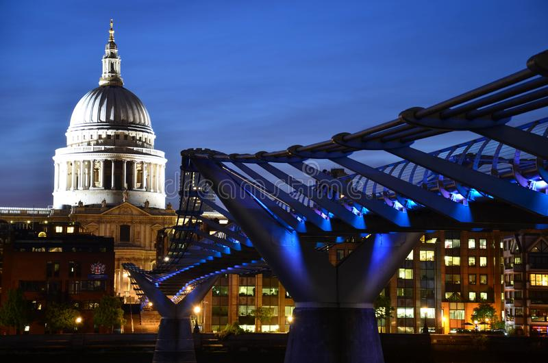 Millennium Bridge and St Paul`s Cathedral at night royalty free stock photo