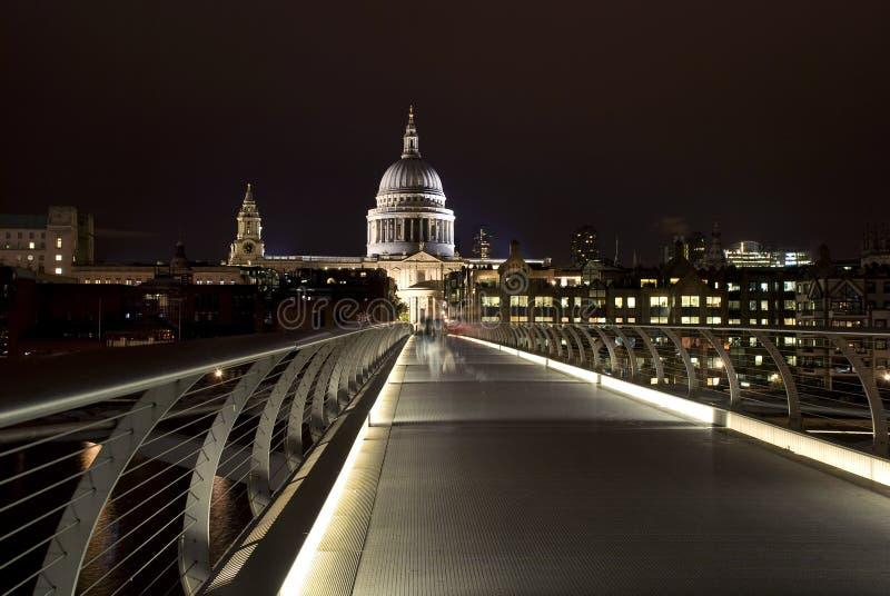 Millennium bridge, london. Saint Paul's Cathedral and the Millennium Bridge in london at night stock photography