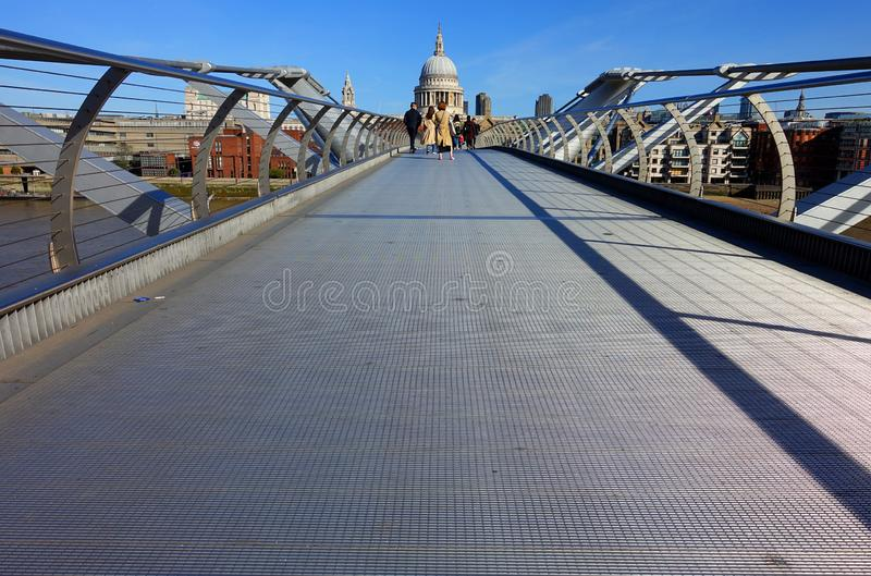 Millennium Bridge Looking from the Tate Gallery to St. Paul's. Ground view of the pedestrian Millennium Bridge in London standing on the side of the Tate stock image