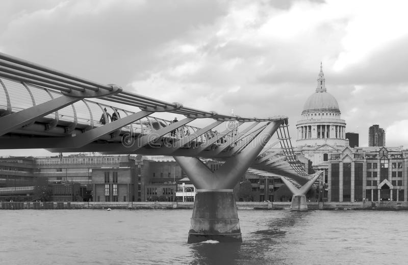 The Millennium Bridge is a pedestrian suspension bridge made of steel, which crosses the River Thames in the city of London. royalty free stock images