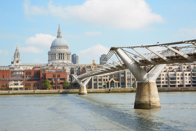 Millennium bridge and St Paul cathedral in London. Millennium bridge and St Paul cathedral in a sunny morning in London stock photos