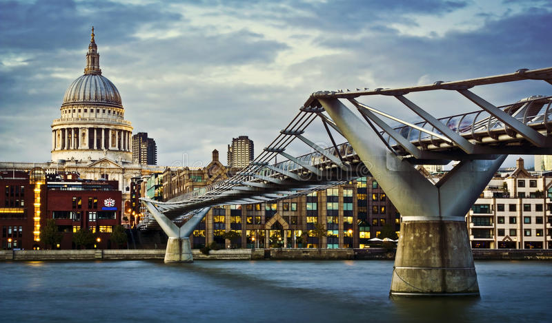 Millennium bridge and St. Paul's cathedral. City of London, Millennium bridge and St. Paul's cathedral at twilight royalty free stock images