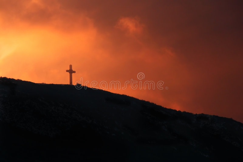 Millennium cross washed in sunset stock photography