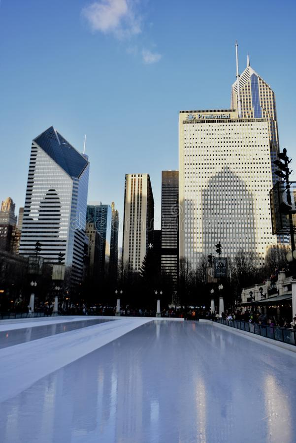 Millennium Park Skating Rink. This is a Late afternoon Winter picture of the cleaning of the iconic Millennium Skating Rink under looming skyscrapers as a royalty free stock images