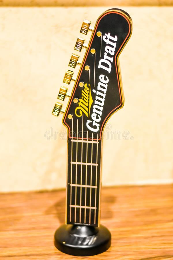 Miller Genuine Draft Beer Tapper Shaped like a Guitar stock image