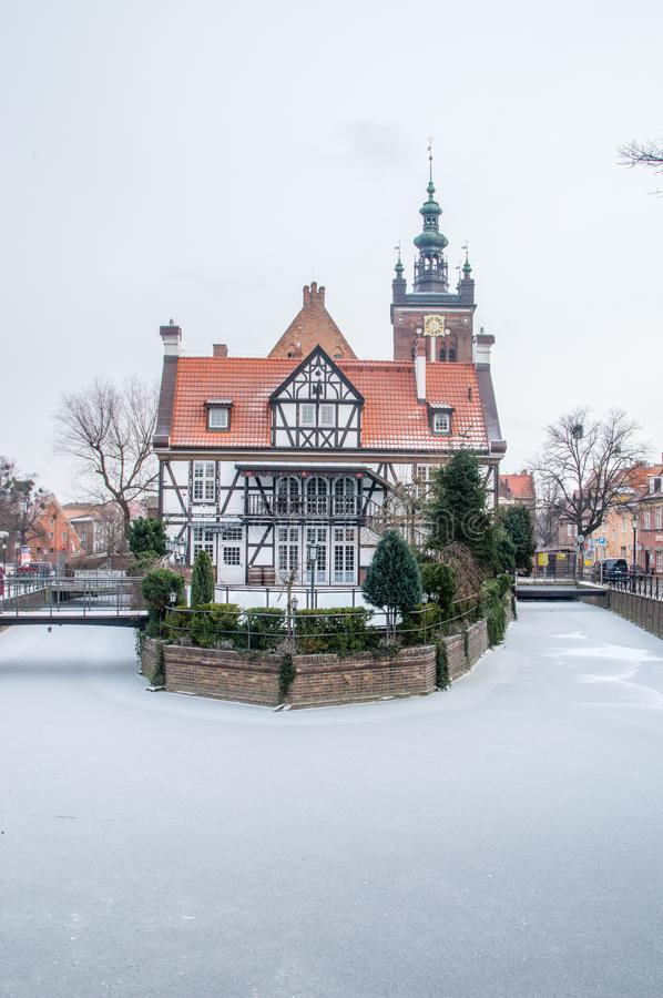 Miller`s House Dom Mlynarza at Mill Island on frozen Raduni .anal. Gdansk, Poland - January 25, 2019: Miller`s House Dom Mlynarza at Mill Island on frozen Raduni royalty free stock image