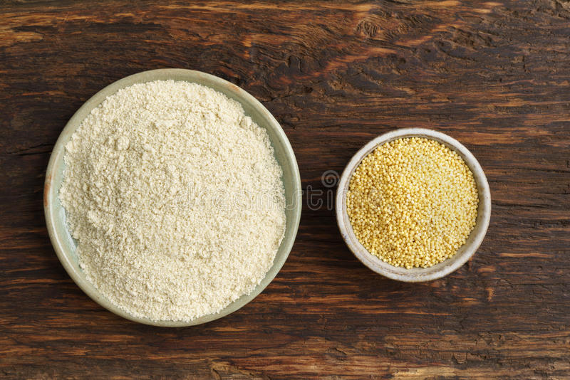 Millet seeds and millet flour royalty free stock images