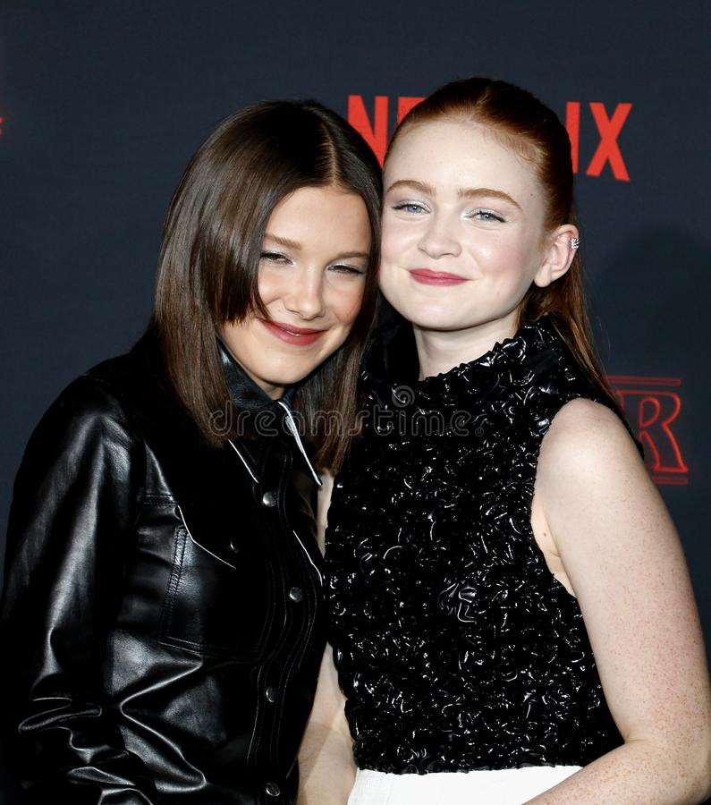 Millie Bobby Brown and Sadie Sink. At the Netflix`s season 2 premiere of `Stranger Things` held at the Regency Village Theatre in Westwood, USA on October 26 stock image