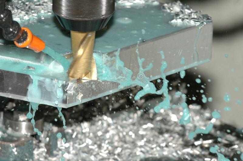 Milling. End mill in cutting position with cullant stock photography