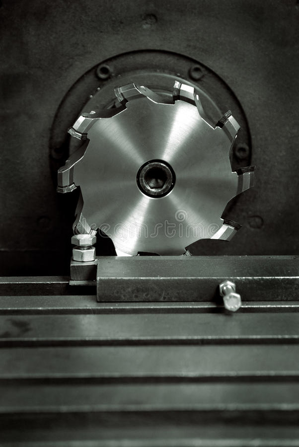 Milling Cutter. /Face Mill A face mill consists of a cutter body that is designed to hold multiple disposable carbide or ceramic tips or inserts used for working royalty free stock photos