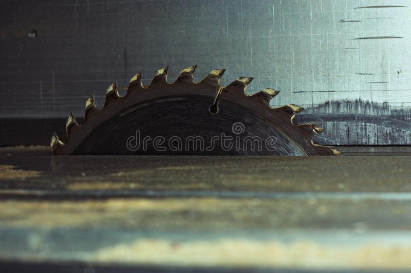 Milling cutter. Metal circular disk. Saw disk. Saw disk on the machine table royalty free stock image