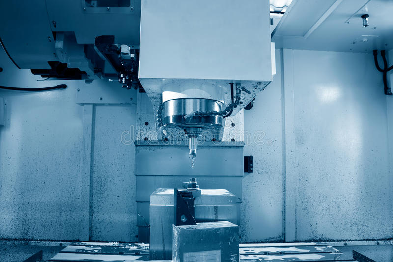 Milling cutting metalworking process. Precision industrial CNC machining of metal detail by mill stock image