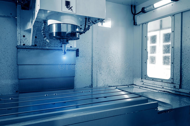 Milling cutting metalworking process. Precision industrial CNC machining of metal detail by mill. At factory stock photography