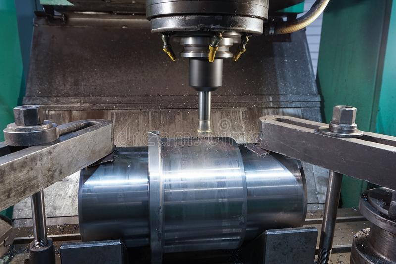 Milling keyway shaft on the CNC machine.  stock images