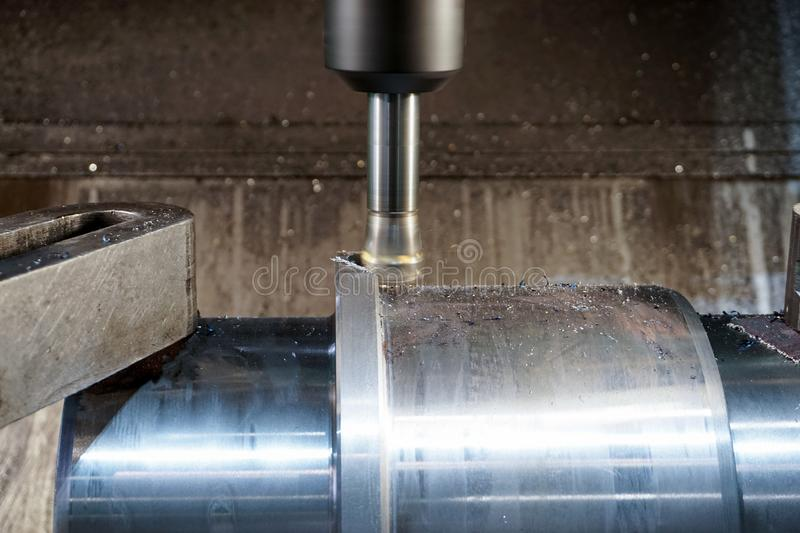 Milling keyway shaft on the CNC machine.  stock photos