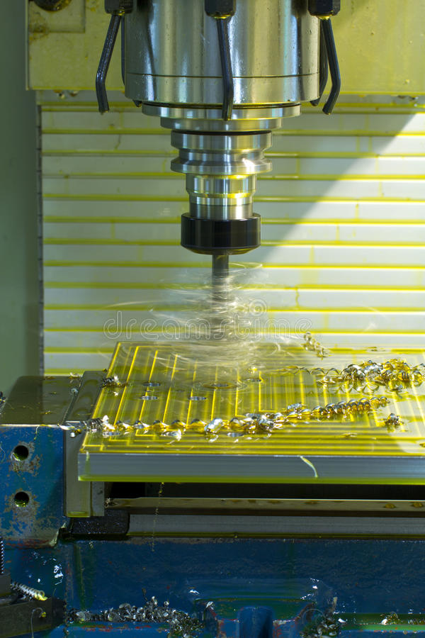 Milling machine CNC. Drill steel on bench vise oil coolant stock image