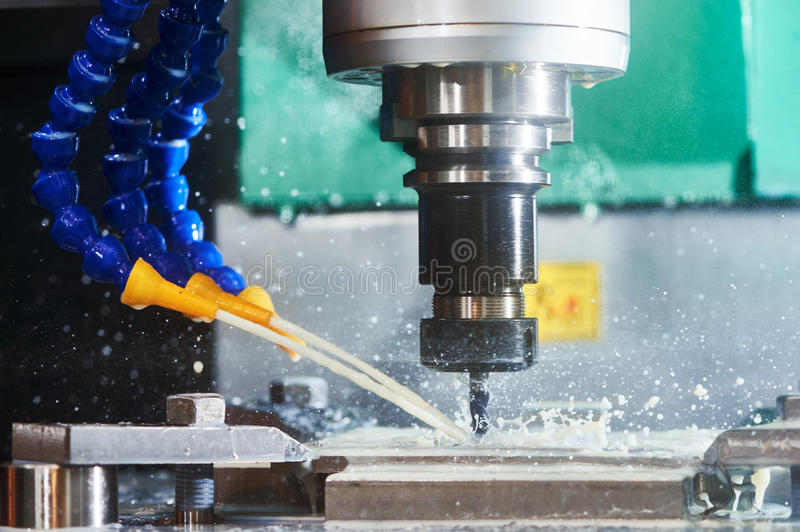 Milling metalwork process. CNC metal machining by vertical mill royalty free stock photo