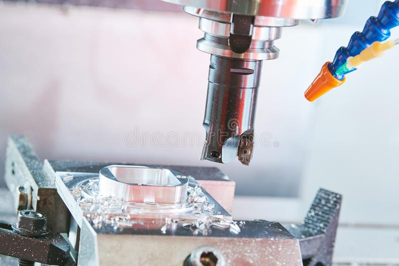 Milling metalworking. Industrial CNC metal machining by vertical mill. royalty free stock photo
