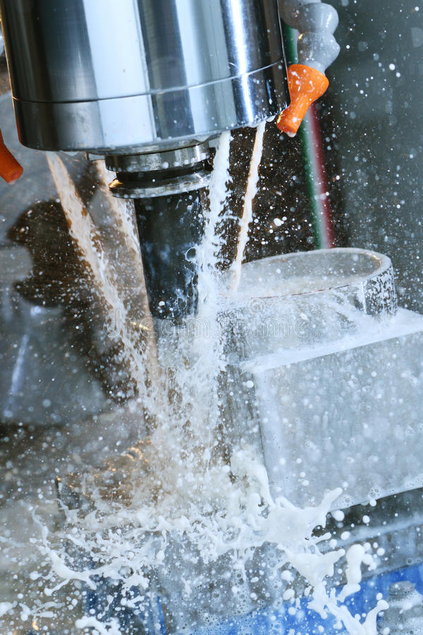 Milling metalworking process. Industrial CNC metal machining by vertical mill royalty free stock images