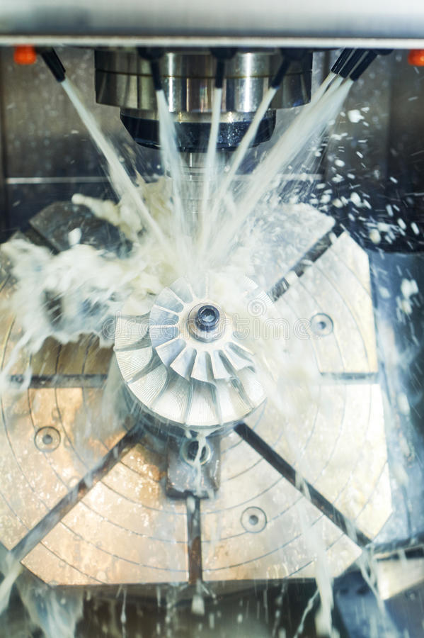 Milling metalworking process. Industrial CNC metal machining by vertical mill stock images