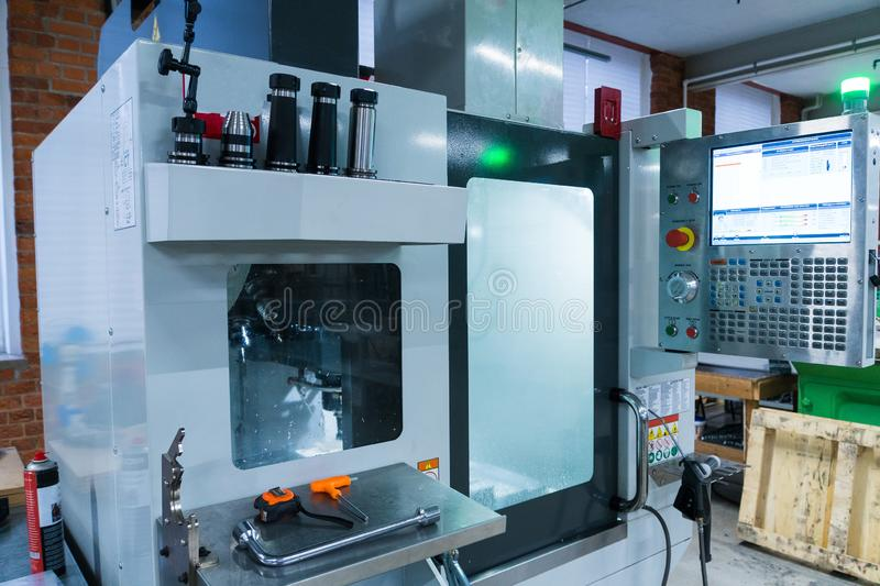 Milling metalworking process. Industrial CNC metal machining by vertical mill stock photography