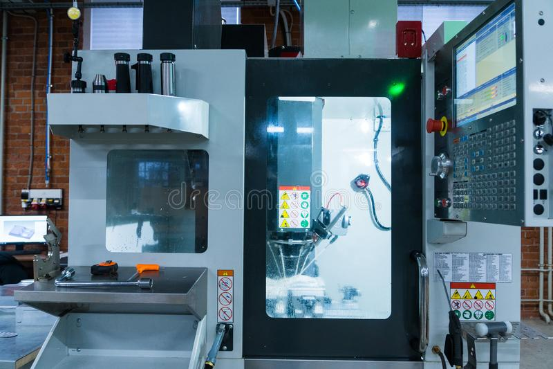 Milling metalworking process. Industrial CNC metal machining by vertical mill.  stock photos
