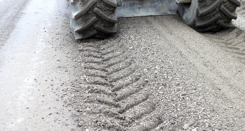 Milling road. Milling asphalt road, reconstruction old road royalty free stock image
