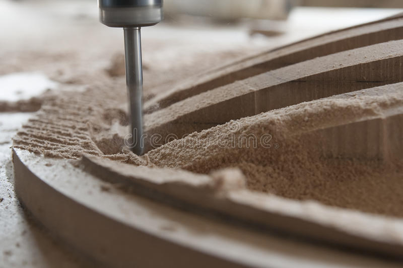 Milling the wood. On the milling machine royalty free stock photo