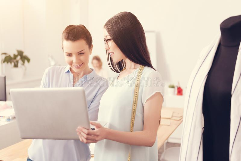 Young designers working together in the studio royalty free stock photography