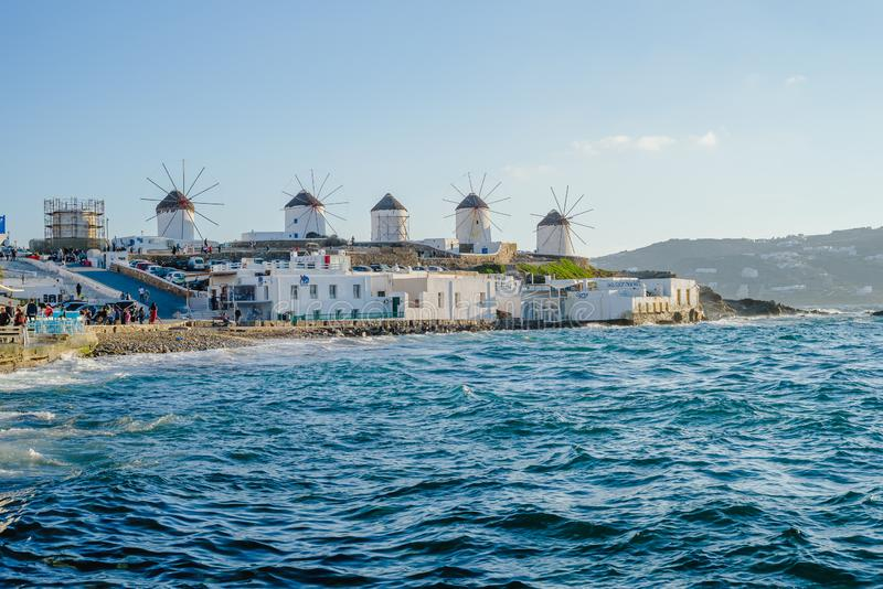Mills on the hill near the sea on the island of Mykonos in Greece - the main attraction of the island. A number of mills on the hill near the sea on the island royalty free stock images