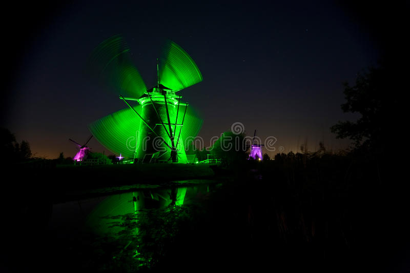 The mills of kinderdijk in colorful floodlight