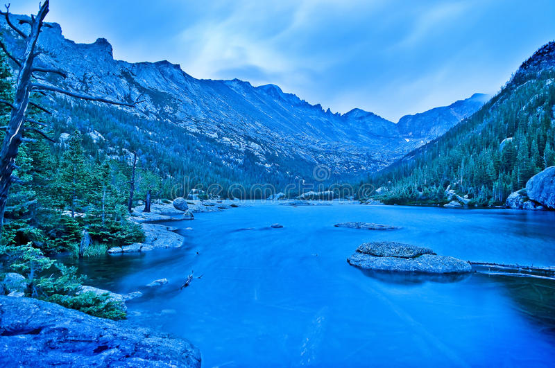 Mills Lake Colorado. Early Morning with dramatic stormy sky at the Mills Lake - Rocky Mountains National stock image