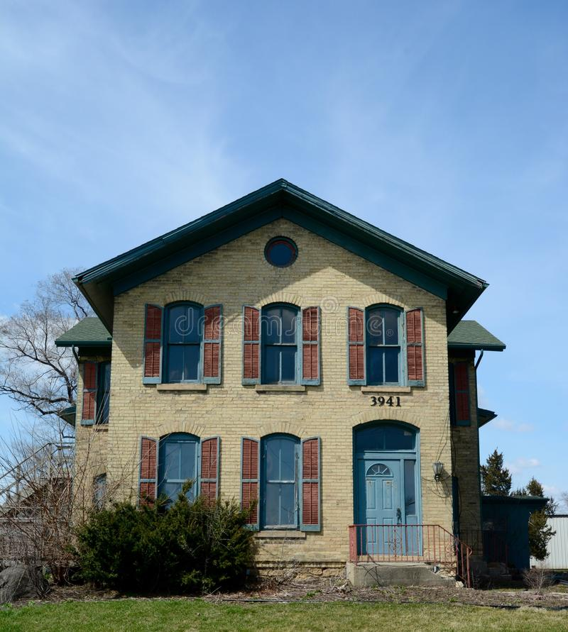 A Milton Italianate. This is a Spring picture of a house located in Milton, Wisconsin. This brick house built in 1880 is an e ample of Italianate architecture stock images