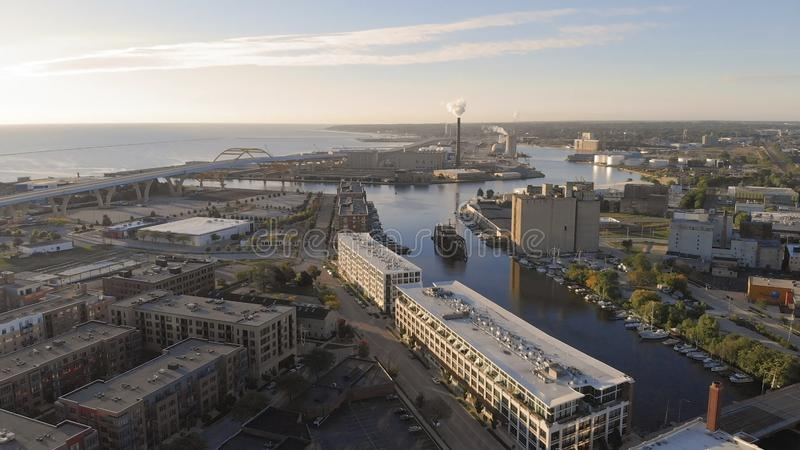 Milwaukee river in downtown, harbor districts of Milwaukee, Wisconsin, United States. Real estate, condos in downtown. Aerial view. Drone flying stock photo