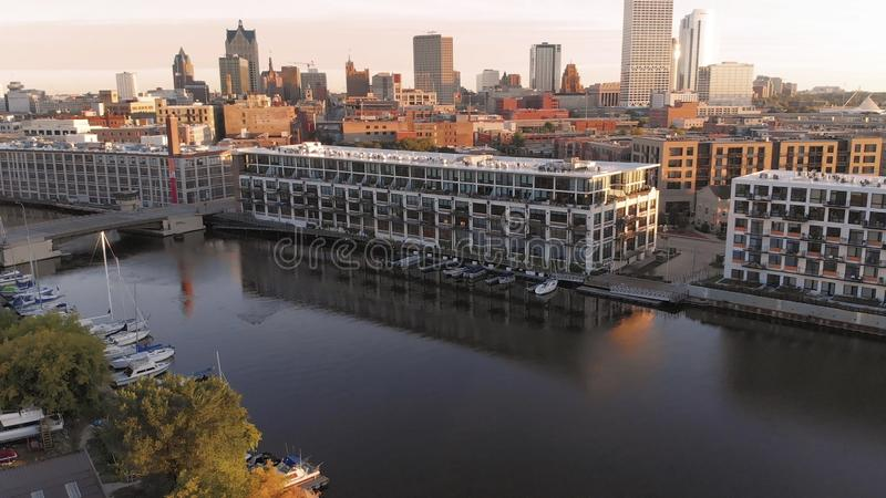 Milwaukee river in downtown, harbor districts of Milwaukee, Wisconsin, United States. Real estate, condos in downtown. Aerial view. Drone flying stock photos