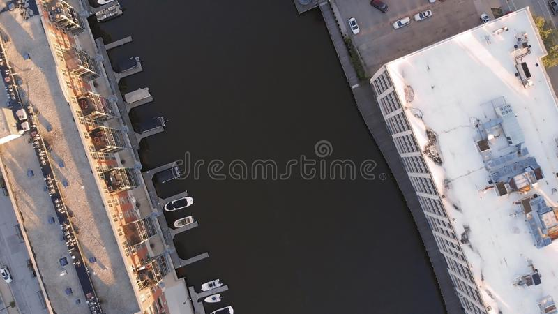 Milwaukee river in downtown, harbor districts of Milwaukee, Wisconsin, United States. Real estate, condos in downtown. Aerial view. Drone flying royalty free stock images