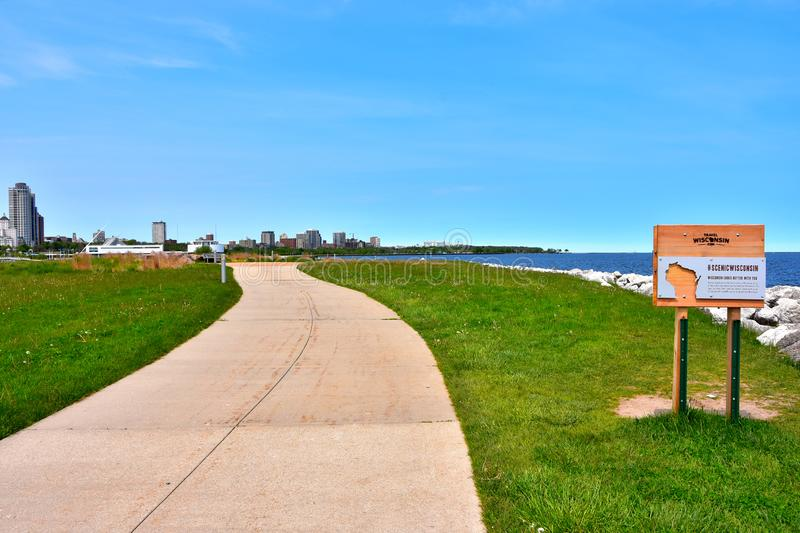 Milwaukee Lakeshore State Park View of City. Milwaukee, Wisconsin / USA - June 3, 2019: The Milwaukee skyline as seen from Lakeshore State Park on a clear spring stock image
