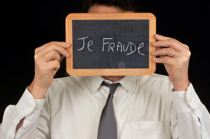 Mim fraude escrita no francês em uma ardósia da escola fotografia de stock royalty free