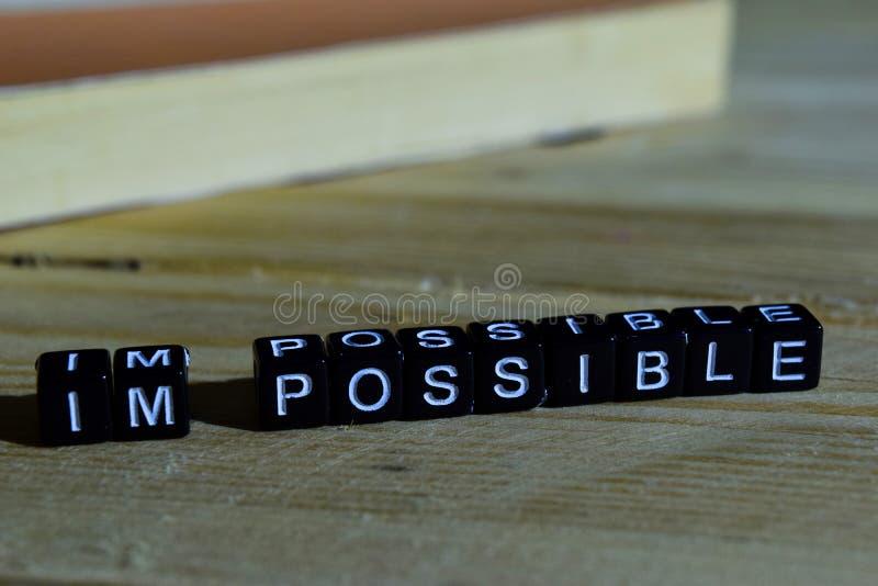 Mim ` m possível em blocos de madeira Conceito da motivação e da inspiração imagens de stock