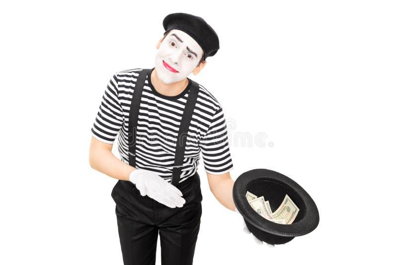 Mima artysty zbieracki pieniądze w kapeluszu obrazy stock