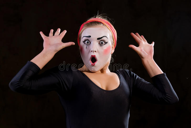 The mime. Portrait of the mime in a make-up on black background stock photos