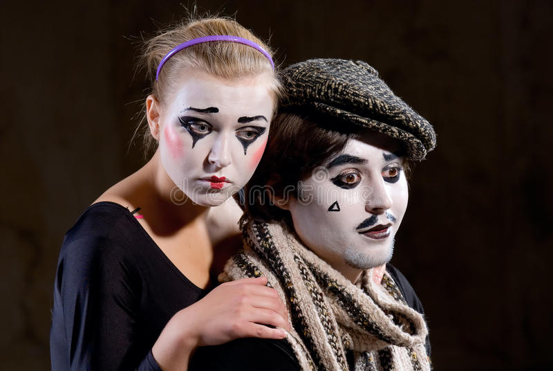The mime. Portrait of the mime in a make-up on black background stock photography