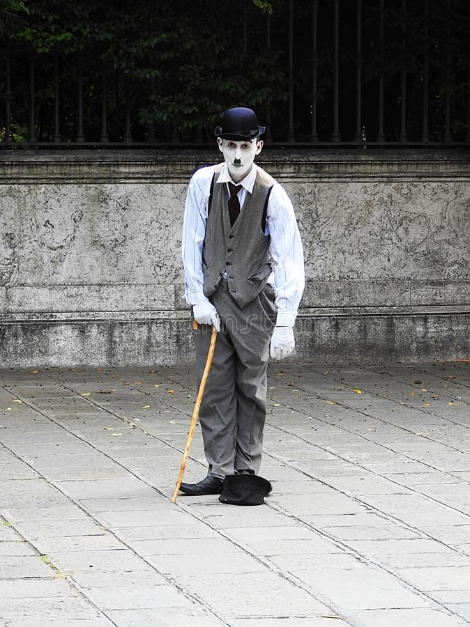 A mime artist dressed as Charlie Chaplin performs in a quiet square in Venice in June 2017 royalty free stock photo