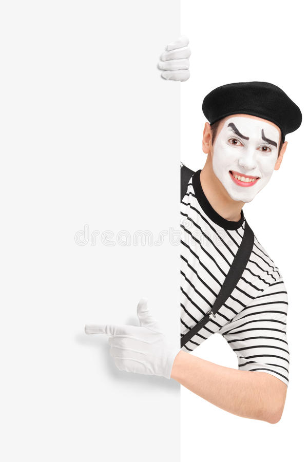 Mime Artist Pointing On A Blank Panel Royalty Free Stock Image