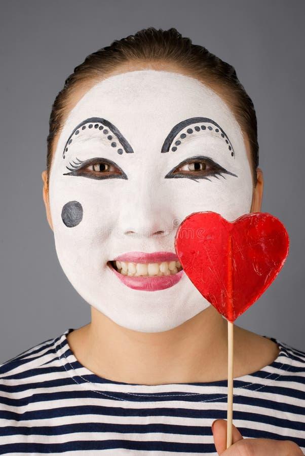 Mime com o lollipop dado forma coração imagem de stock