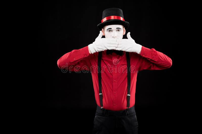 mime covering mouth with hands royalty free stock images