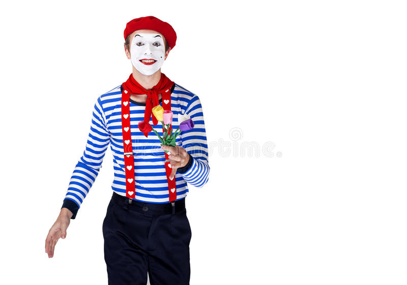 Mime with flower.Emotional funny actor wearing stock photos