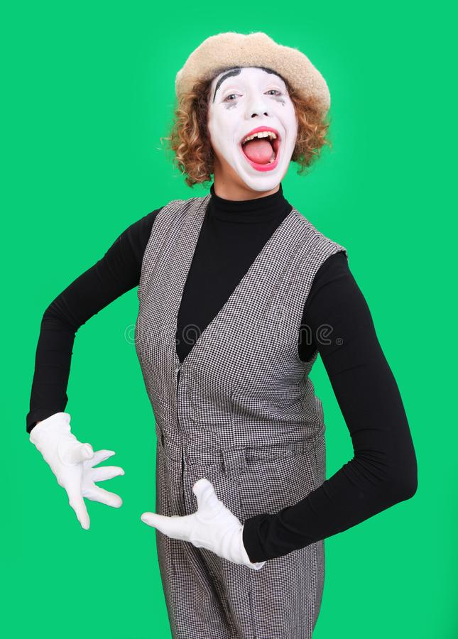 Performing mime isolated on green stock photo