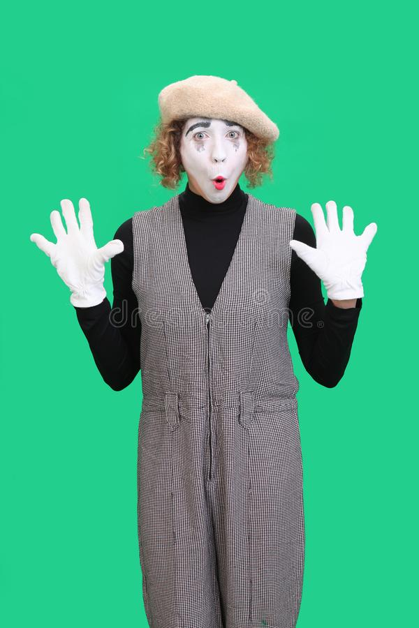Performing mime isolated on green royalty free stock image