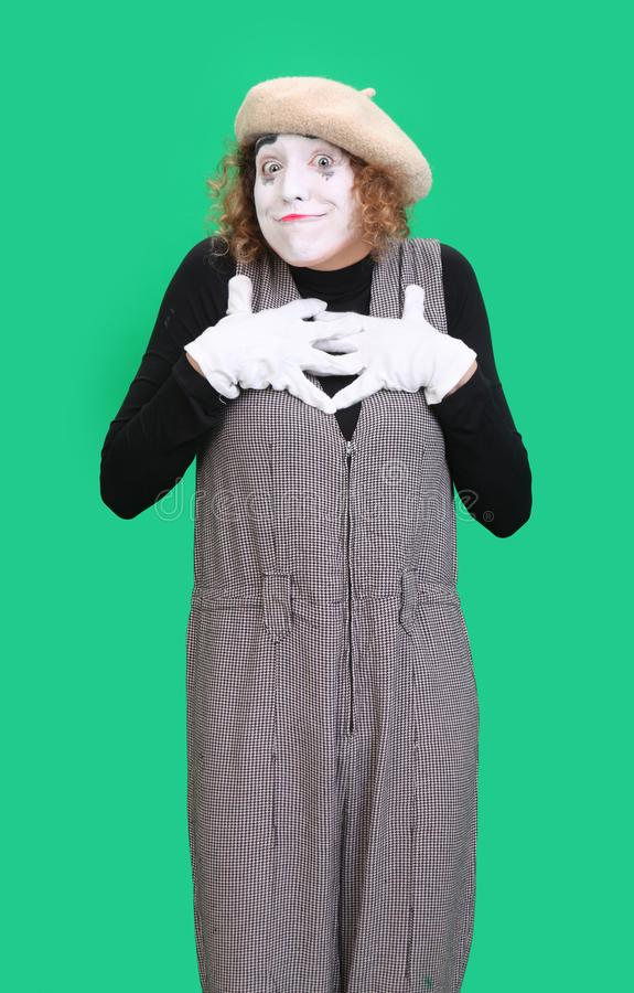 Performing mime isolated on green stock photography
